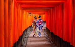 Japan Tour - Women in Kimonos Walking Through the Fushimi Inari-taisha Shrine