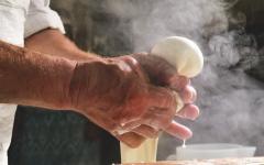 A homemade cheese producer produces handmade mozzarella cheese.
