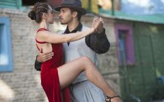 a couple look into each others eyes whilst dancing the tango