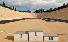 A podium placed in the middle of an empty Panathenaic Stadium or Kallimarmaro | Athens Greece