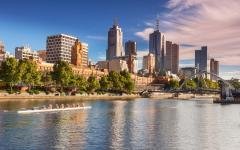 australia melbourne city skyline with rowing boat on the southbank river