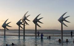 the sculpture in cairns lagoon at sunset