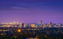 a view from the hills of the adelaide city skyline at twilight with building and city lights
