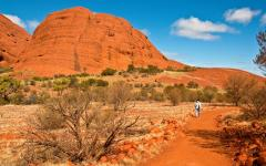 australia orange sandstone rock with lone traveller