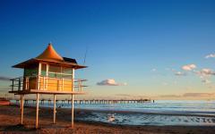 australia beach lifeguard tower at sunset