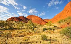 landscape view of kata tjuta red rock formations against a vast blue sky in alice springs