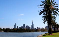 the lake in albert park with skyscrapers in the background