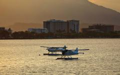 australia two sea planes on water sunset