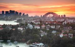 australia sydney harbor and city skyline at sunset