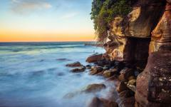 australia sydney bondi beach at sunset waves and rocks