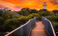 wooden walkway to the lighthouse at cape tourville freycinet peninsula at sunrise