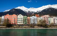 colorful houses against a backdrop of snowy mountains in innsbruck