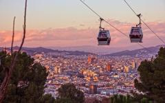 spain barcelona the montjuic cable car overlooks the city at sunset