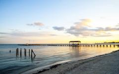 Sunsert over beautiful pier in Belize.