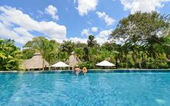 People enjoying the infinity pool at Chaa Creek in Belize. Photo courtesy of Chaa Creek.