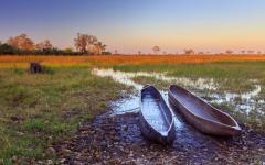 Boats on the Okavango Delta at sunrise.