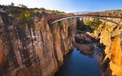 Bridge stretching across a canyon at Bourke's Potholes | Mpumalanga, South Africa