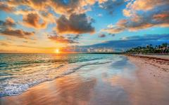 Colorful sunrise over the ocean and beach