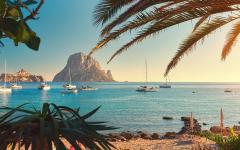 spain ibiza beautiful view of boats on the water and beach at sunset