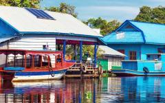 Colorful village on river in Cambodia.