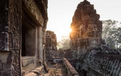 sun bursts onto buddhist temple ruins