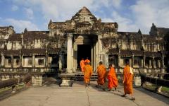 buddhist monks enter into an ancient temple