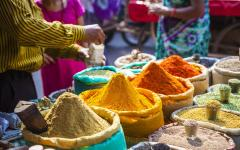 Vibrantly colored spices in a traditional street market.