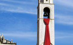 A cravat, or necktie, temporarily hangs from the clock tower in Dubrovnik.