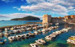 Dubrovnik port filled with boats.