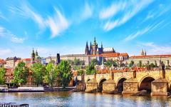 View across the Vltava River to Charles Bridge and Prague Castle.