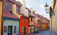 A row of colorful houses in Zlata Ulice, known as Golden Street, Prague.