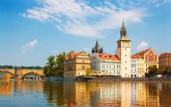 Looking across the Vltava River to buildings next to Charles Bridge, Prague