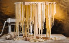 Homemade traditional Italian tagliatelle pasta.