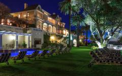 View of the elegant mansion of Ellerman House at night | Cape Town,  South Africa