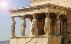 Caryatid pillars on the Erechtheion Temple in Acropolis, Greece at midday