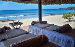 Private couples massage on the beach.