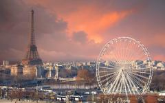 view of the Grande Roue de Paris and the Effiel Tower on a stormy evening