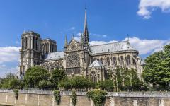 the medieval Notre-Dame Cathedral stands next to the Seine River in Paris