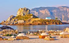View of the stone ruins and rocky terrain of Kastri Island in Greece