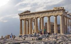 The Parthenon temple with a group of people in the foreground admiring its beauty | Athens, Greece