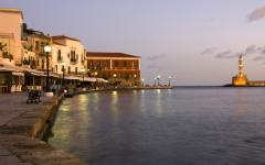 View of Chania Harbor at night with the Lighthouse of Chania in the background | Crete, Greece