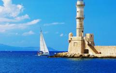 Sailboat sailing around the Lighthouse of Chania in Crete, Greece