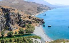 Gorgeous view of Megas Potamos River flowing into Palm Beach in Preveli, Crete, Greece