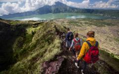 Hikers walking along the caldera of Mount Batur.
