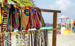 Headbands and necklaces for sale on the beach.