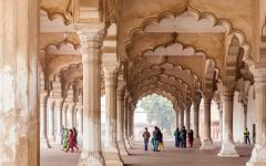 Tourist admiring the unique architecture of the Hall of Public Audience or Diwan-I-Am in Agra India