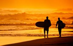 Surfers on Kuta Beach in Bali.