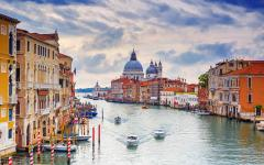 The grand canal with Santa Maria della Salute in the distance, Venice, Italy.