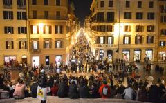 People gather on the Spanish Steps looking onto the Piazza di Spagna in Rome, Italy.