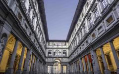 An evening shot of the Uffizi Gallery from the courtyard, in Florence.